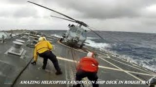Amazing military helicopter landing on ship deck in rough seas
